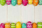Easter egg frame against white wood