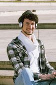 Boy Whit Headphones Smiling