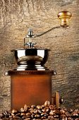 Wooden coffee grinder with roasted coffee beans