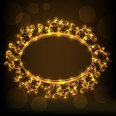 Beautiful floral design decorated golden frame in oval shape on shiny brown background.