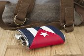 Flask With The Cuban Flag And The Backpack