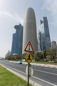 DOHA, Qatar - February 11, 2015: Crossing sign showing an Arab in traditional dress on the Corniche Road.