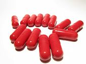stock photo of overdose  - a couple of red capsules isolated on white background - JPG