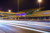 DUBAI - OCT 14: Dubai metro at night on October 14, 2014. Dubai is the most populous city and emirate in the UAE, and the second largest emirate by territorial size after the capital, Abu Dhabi
