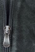 stock photo of zipper  - Open zipper on black suede leatherr Closeup of a zipper of a suede leather - JPG