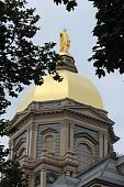 stock photo of notre dame  - The Notre Dame Golden Dome in the summer - JPG