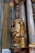 GRAZ, AUSTRIA - JANUARY 10, 2015: Saint Ambrose, altar of Saint John of God in Barmherzigenkirche church in Graz, Styria, Austria on January 10, 2015.