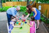 Children Dyeing Easter Eggs With Mother And Father