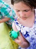 Girl Holds Her Dyed Green Easter Egg
