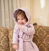 Baby girl in a plush bathrobe