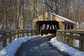 stock photo of covered bridge  - Walkway to a covered bridge at the park on a cold - JPG