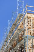 Scaffolding and Wood Framing at Construction Site.