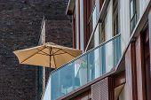 Beach umbrella on an apartment patio Hamburg Germany