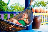 Cute Kid, Boy Relaxing In Hammock. Enjoying Life On Tropical Island