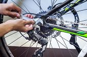 stock photo of bicycle gear  - Repairing old bicycle for the new owner - JPG