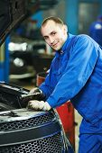 auto repairman mechanic portrait in car auto repair or maintenance shop service station