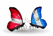 Two Butterflies With Flags On Wings As Symbol Of Relations Latvia And Guatemala