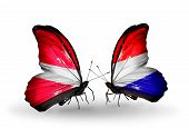 pic of holland flag  - Two butterflies with flags on wings as symbol of relations Latvia and Holland - JPG