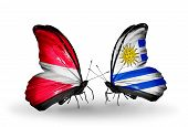 Two Butterflies With Flags On Wings As Symbol Of Relations Latvia And Uruguay
