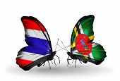 Two Butterflies With Flags On Wings As Symbol Of Relations Thailand And Dominica