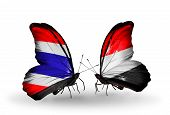 Two Butterflies With Flags On Wings As Symbol Of Relations Thailand And Yemen