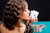 Young Woman With Poker Cards
