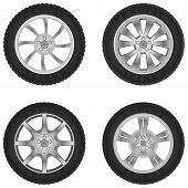 image of four-wheel  - Four random cars wheels on white background - JPG