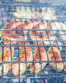 Barbecue sausages on grill