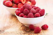 strawberries, blueberries, blackberries and raspberries in bowls, top view