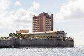 stock photo of curacao  - Hotel built on point of land on site of old fort on Curacao - JPG