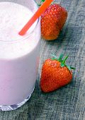 pic of strawberry  - Strawberry milk shake with strawberries on wooden background soft focus on strawberry - JPG