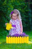 foto of little young child children girl toddler  - Child working in the garden - JPG