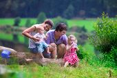 stock photo of mother baby nature  - Family on summer hike - JPG