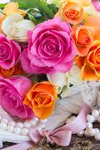 foto of mother-of-pearl  - fresh pink and orange roses with  pearls - JPG