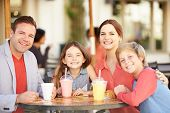 stock photo of 13 year old  - Family Enjoying Snack In Caf - JPG