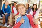stock photo of pre-adolescent child  - Group Of Children Hanging Out Together In Mall - JPG