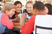 picture of pre-adolescent child  - Group Of Children In Caf - JPG