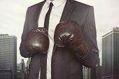 foto of boxing day  - Businessman in boxing gloves and suit on cityscape background - JPG