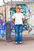 foto of skate  - boy resting with skate board at the skate park - JPG
