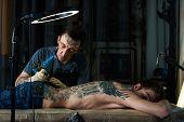 picture of freaky  - Dark studio of working freaky tattoo artist - JPG