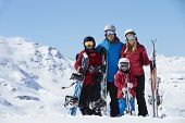 picture of family ski vacation  - Family On Ski Holiday In Mountains - JPG