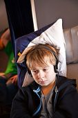 picture of business class  - child is relaxing and watching a film in an aircraft in business class - JPG