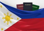 image of filipina  - Philippines flag and three passports in different colors - JPG