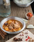 picture of curry chicken  - Chicken Mussaman Curry with ingredient Spices and herbs - JPG