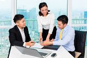 stock photo of counseling  - Asian banker counseling client finance investment in bank office  - JPG