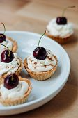 foto of whip-hand  - Cooking of little homemade oat tarts with whipped cream - JPG