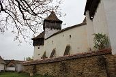 pic of fortified wall  - Medieval fortified church surrounded by defence walls - JPG