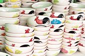pic of roosters  - Ceramic rooster bowl from Lampang on sell in local marketThailand - JPG