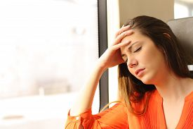 foto of fatigue  - Passenger traveling and feeling dizzy with headache in a train travel - JPG