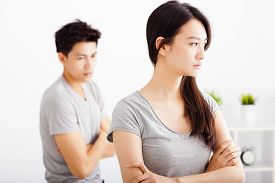 stock photo of not talking  - young Couple not talking after fight in living room - JPG
